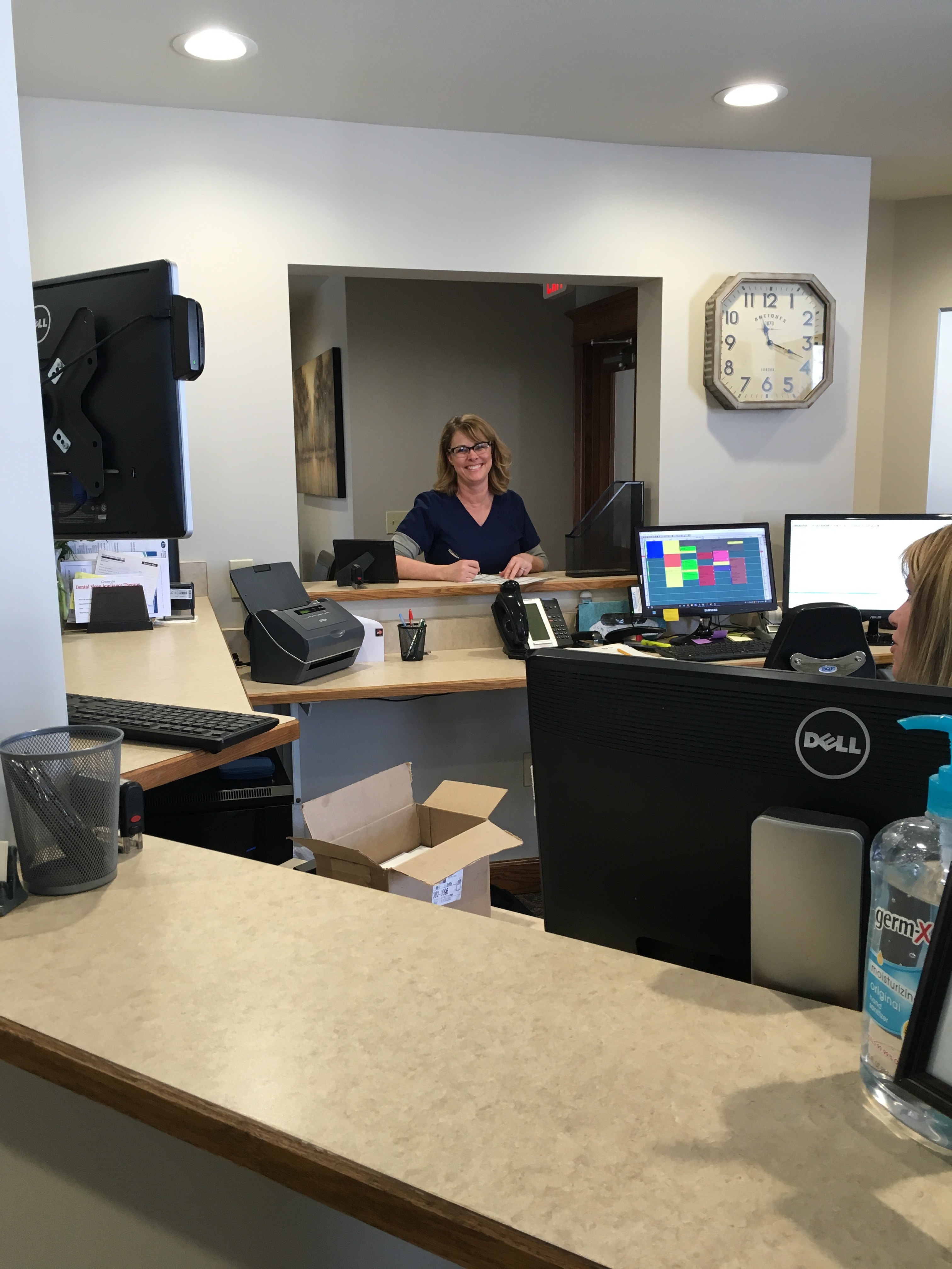 We now have three separate checkout windows for increased patient privacy. Our veteran assistant Sherri is pictured filling out a referral for a patient.