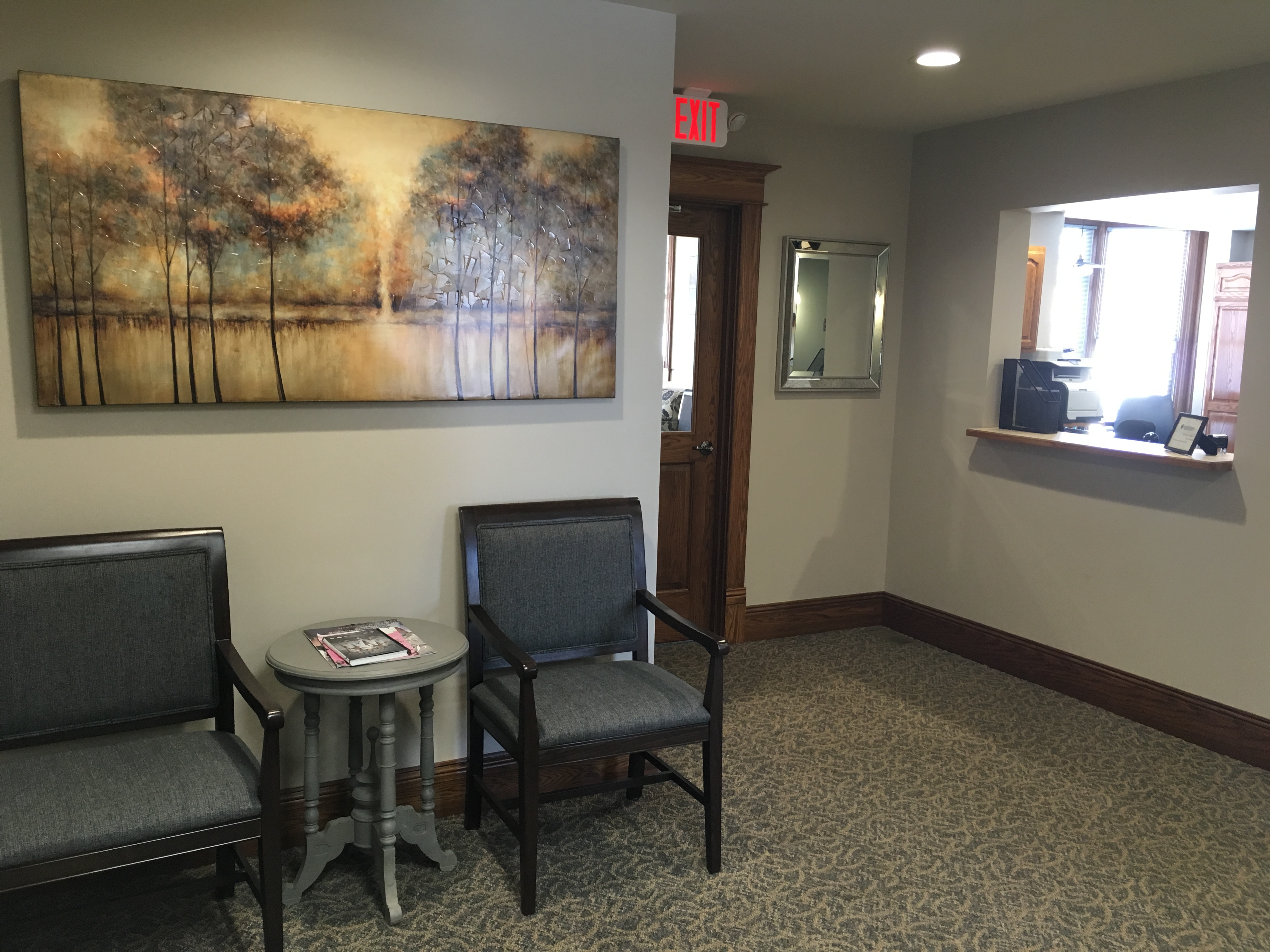 This is a sitting area for patients waiting to checkout. We made sure to include a mirror again so you can check out your smile before you go!