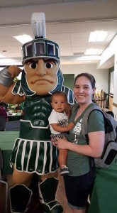 Dr. Erin with her son Trip and Sparty celebrating her mother's retirement from MSU
